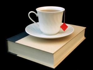 teacup atop book