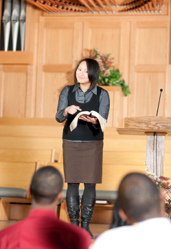 Woman preaching in church