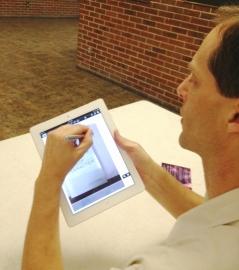 Jeff signing iPad