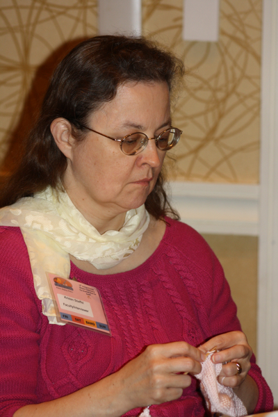 "Here's me knitting at FWA a couple of years ago. I didn't realize I look so grumpy when I knit. Call it ""resting knit face."" • Photo by Karen Lieb."