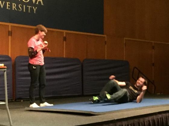 Carla Cook Hoch demonstrates her Jujitsu moves on Ben Wolf. Photo by Kristen Stieffel.
